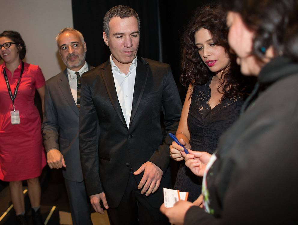 Director Javier Fuentes-Le&oacute;n, left, and stars Salvador del Solar and Angie Cepeda of The Vanished Elephant greet the audience following the film's premier at the Toronto International Film Festival in Toronto, Ontario, September 6, 2014.<br /> AFP PHOTO/Geoff Robins