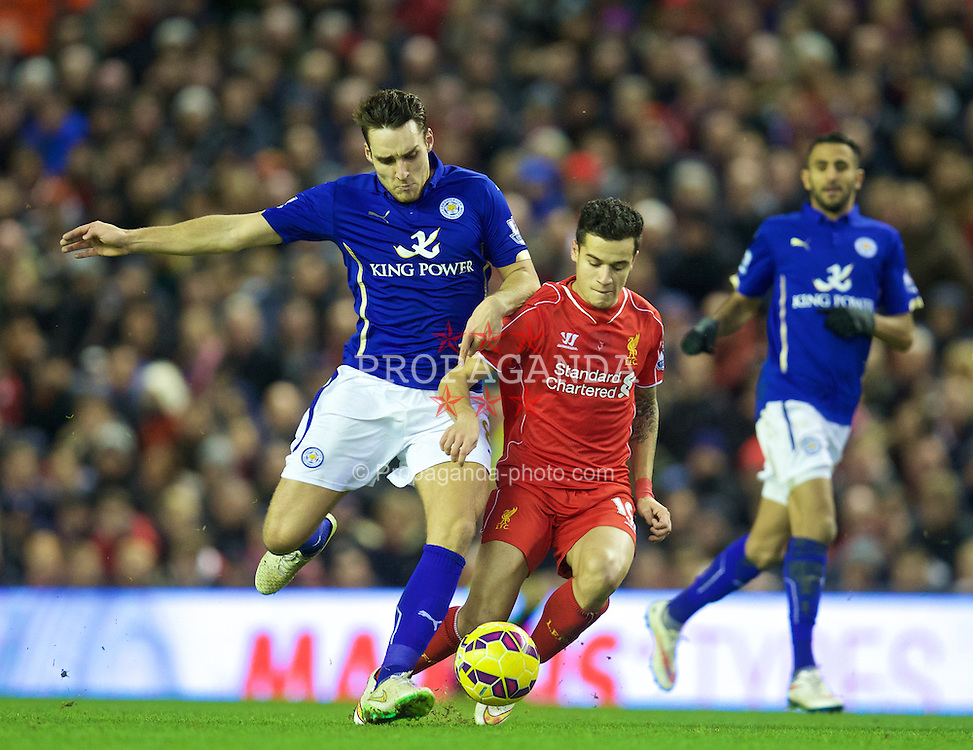 LIVERPOOL, ENGLAND - Thursday, New Year's Day, January 1, 2015: Liverpool's Philippe Coutinho Correia and Leicester City's Matty James during the Premier League match at Anfield. (Pic by David Rawcliffe/Propaganda)