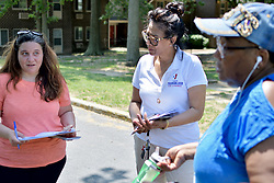 Tanzie Youngblood (center) canvassing ahead of the June 5 Primaries.