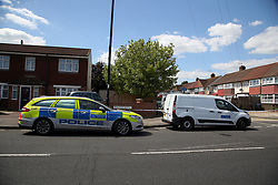 © Licensed to London News Pictures. 17/07/2020. London, UK. Police cars on Lytton Avenue, Enfield, in north London as police launch a murder investigation following the death of a man in his 30s. Police were called at 04:45hrs early this morning, to a report of four men fighting in Lytton Avenue, Enfield and a man being put into a vehicle. Later the victim died from a single stab wound in North Middlesex Hospital. Three men, no further details, have been arrested on suspicion of murder; all remain in custody. Photo credit: Dinendra Haria/LNP