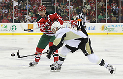 Mar 17; Newark, NJ, USA; New Jersey Devils left wing Ilya Kovalchuk (17) passes the puck past Pittsburgh Penguins right wing Pascal Dupuis (9) during the second period at the Prudential Center.