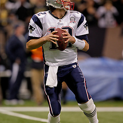 2009 November 30: New England Patriots quarterback Tom Brady (12) drops back to pass during a 38-17 win by the New Orleans Saints over the New England Patriots at the Louisiana Superdome in New Orleans, Louisiana.