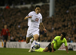London, England - Wednesday, March 14, 2007: Tottenham Hotspur's Young-Pyo Lee and SC Braga's Andrade during the UEFA Cup match at White Hart Lane. (Pic by Chris Ratcliffe/Propaganda)