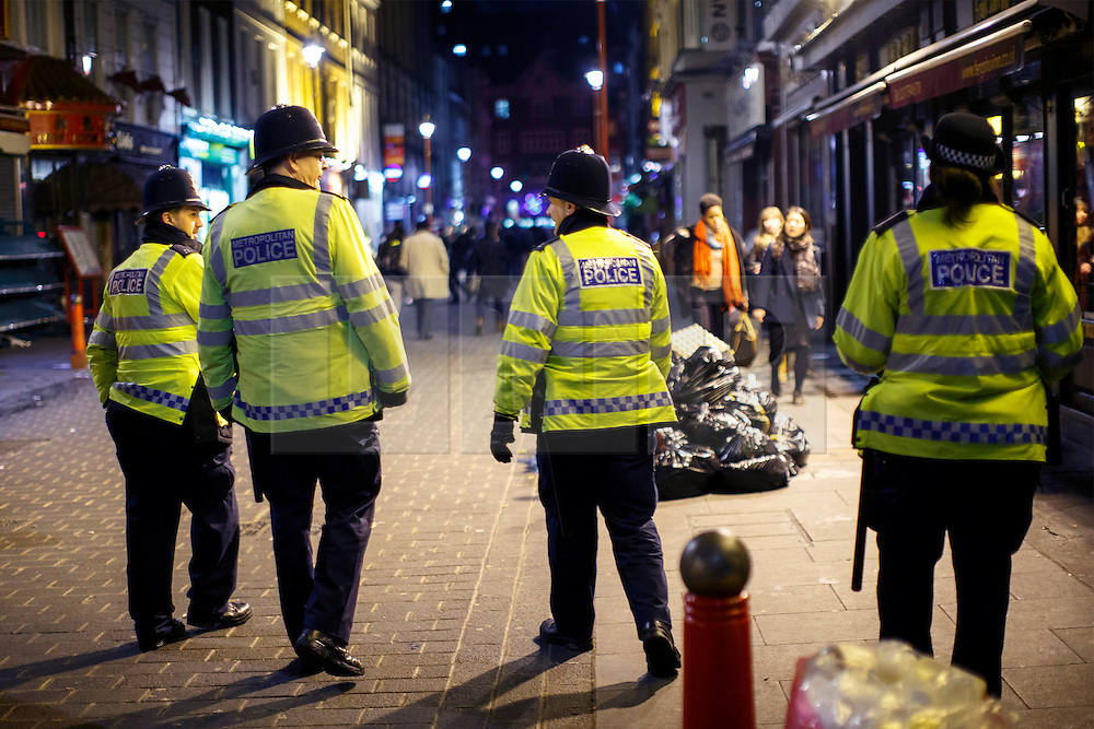 © Licensed to London News Pictures. 01/01/2016. London, UK. Police officers patrolling in central London at the first hours of 2016 on January 1, 2016. Photo credit: Tolga Akmen/LNP