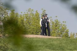 © Licensed to London News Pictures. 11/04/2020. London, UK. Police officers watch over Primrose Hill in London during a pandemic outbreak of the Coronavirus COVID-19 disease. The public have been told they can only leave their homes when absolutely essential, in an attempt to fight the spread of coronavirus COVID-19 disease. Photo credit: Ben Cawthra/LNP