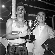 26/01/1962<br /> 01/26/1962<br /> 26 January 1962<br /> Irish Amateur National Junior Boxing Championships at the National Stadium, Dublin. Cpl. T. Doyle, (Army and Consolata) Light/Welterweight Champion with his cup.