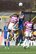 Paul Robinson of AFC Wimbledon out jumps Aaron Mclean during the Sky Bet League 2 match between AFC Wimbledon and Barnet at the Cherry Red Records Stadium, Kingston, England on 3 October 2015. Photo by Stuart Butcher.