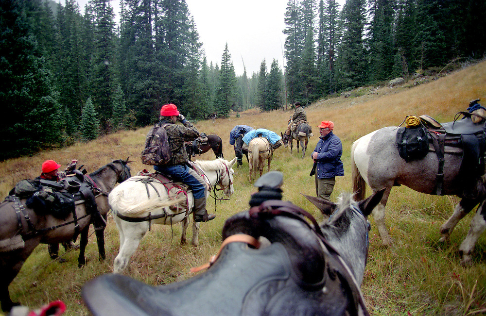 Packing into base camp by horseback for a hunt in the Colorado Rocky Mountains