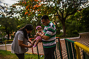 Military officer and Guarani student Nestor Melgarejo and his wife, actress and Guarani teacher Graciela Brandel put shoes on her 6 month-old Anai (a Guarani name) as they put her to play at a park in Asuncion, Paraguay, Thursday, Dec., 14, 2017. Paraguay today is trying to promote a positive image of Guaraní language, the native oral language that survived centuries of subjugation rendering it as a second class idiom in the minds of many Paraguayans that associated it with poverty, rurality, ignorance and illiteracy. Today, the number of babies being given Guaraní names is on the rise. As is the amount of businesses using Guaraní names.(Dado Galdieri for The New York Times)