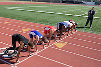 Athletes ready to run, high angle view