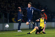 Jake Buxton tackles Stephen Humphrys during the EFL Sky Bet League 1 match between Burton Albion and Southend United at the Pirelli Stadium, Burton upon Trent, England on 3 December 2019.