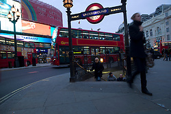 UK ENGLAND LONDON 23NOV11 - Street scene at an exit of Piccadilly Circus tube station in the West End, central London.....jre/Photo by Jiri Rezac....© Jiri Rezac 2011