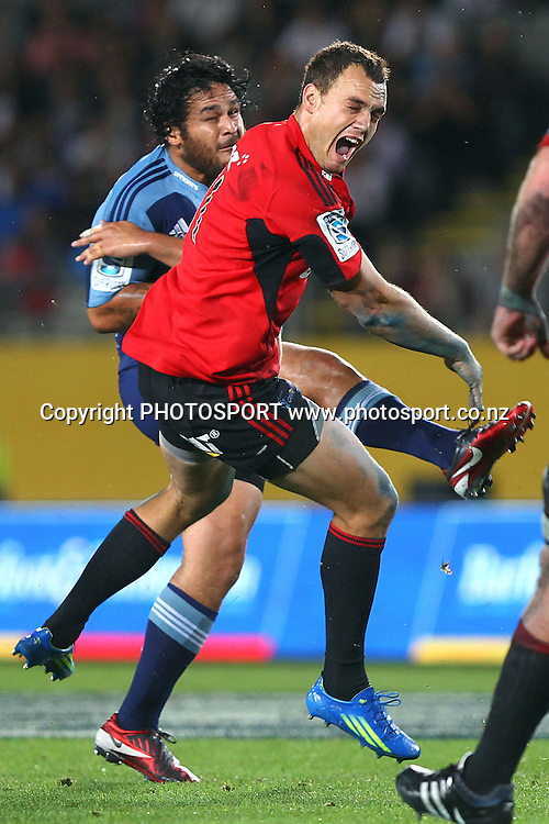 Crusaders' Israel Dagg charges down the drop goal from Blues' Piri Weepu. Super Rugby rugby union match, Blues v Crusaders at Eden Park, Auckland, New Zealand. Friday 24th February 2012. Photo: Anthony Au-Yeung / photosport.co.nz