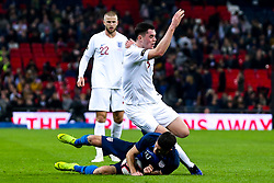 Michael Keane of England fouls Christian Pulisic of USA - Mandatory by-line: Robbie Stephenson/JMP - 15/11/2018 - FOOTBALL - Wembley Stadium - London, England - England v United States of America - International Friendly