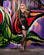 Houston Model and actress Savannah O'Hara poses in club attire in front of vivid graffitti art wall.