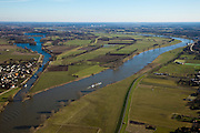 Nederland, Limburg, grens Noord-Brabant - Limburg, 07-03-2010; Rechts de Maas, links oude Maasarm en Mook. Op de landtong het dorpje Middelaar. Het gebied links van de rivier in Noord-Limburg is onderwerp van gemeentelijke herindeling..Right Meuse, left old Maasarm and Mook. On the peninsula the village Middelaar. The area left of the river in Northern Limburg is the subject of municipal reorganization..luchtfoto (toeslag), aerial photo (additional fee required).foto/photo Siebe Swart