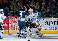KELOWNA, CANADA - APRIL 5: Madison Bowey #4 of the Kelowna Rockets checks Justin Hickman #9 of the Seattle Thunderbirds on April 5, 2014 during Game 2 of the second round of WHL Playoffs at Prospera Place in Kelowna, British Columbia, Canada.   (Photo by Marissa Baecker/Getty Images)  *** Local Caption *** Madison Bowey; Justin Hickman;