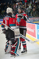 KELOWNA, CANADA - NOVEMBER 7: Madison Bowey #4 congratulates Jackson Whistle #1 of Kelowna Rockets on the win against the Spokane Chiefs on November 7, 2014 at Prospera Place in Kelowna, British Columbia, Canada.  (Photo by Marissa Baecker/Shoot the Breeze)  *** Local Caption *** Madison Bowey; Jackson Whistle;