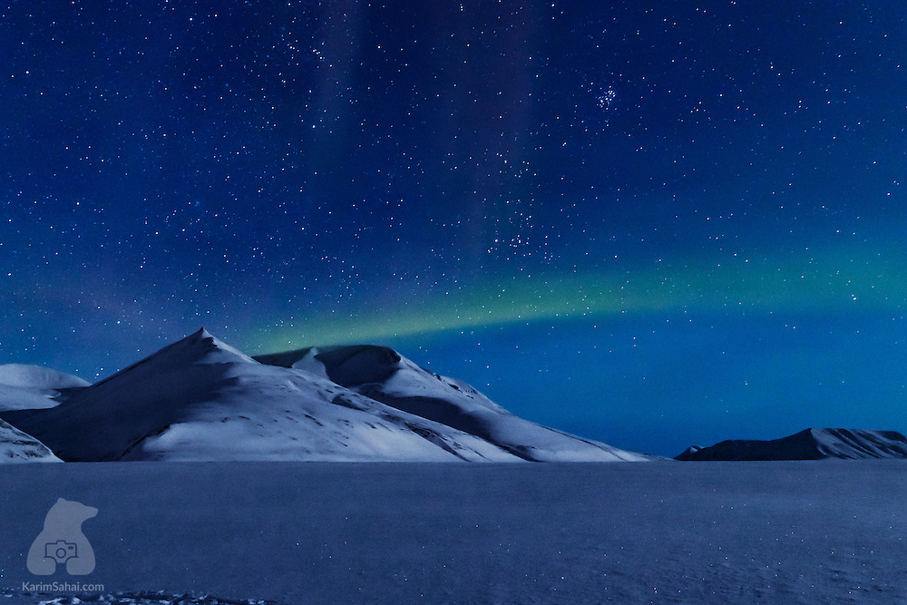 An infinity of stars, a crisp -15C (5F) night, moon light softly wrapping the endless frozen landscape and a hint of an aurora borealis; the magic of Svalbard during the Polar Night months never ceases to amaze.