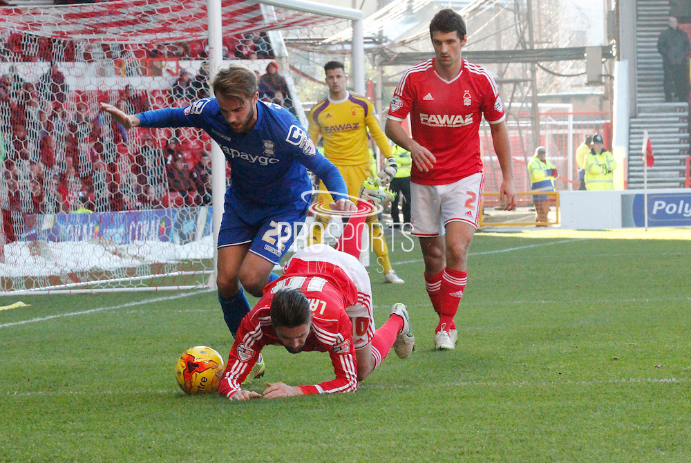 Andy Shinnie and Henri Lansbury during the Sky Bet Championship match between Nottingham Forest and Birmingham City at the City Ground, Nottingham, England on 28 December 2014. Photo by Jodie Minter.