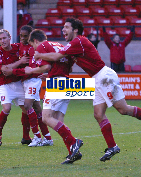 Photo: Dave Linney.<br />Walsall v Yeovil Town. The FA Cup. 03/12/2005.<br />Matty Fryatt  scores from the spot and is mobbed by Jorge  Leitao