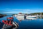 Small fire boat in Saquatucket Harbor, Harwich, Cape Cod, Massachusetts, USA.