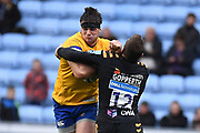 Bath back row Josh Bayliss (7) is hit by Wasps flyhalf Jimmy Gopperth (12) during the Gallagher Premiership Rugby match between Wasps and Bath Rugby at the Ricoh Arena, Coventry, England on 2 November 2019.