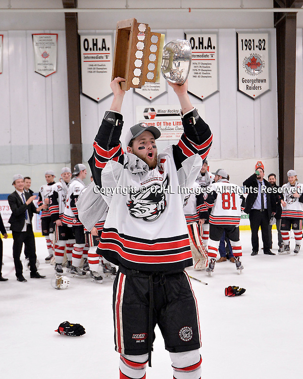 GEORGETOWN, ON  - APR 26,  2017: Ontario Junior Hockey League, Championship Series.  Georgetown Raiders vs the Trenton Golden Hawks in Game 7 of the Buckland Cup Final.  Griffin James #4 of the Georgetown Raiders hoists the Buckland Cup.<br /> (Photo by Shawn Muir / OJHL Images)