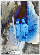 two little girls posing on a severely eroded glass plate photo
