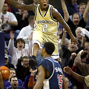 Even University of Washington basketball star Nate Robinson seems surprised how high he jumped as he soars over the University of Arizona Wildcats in Seattle on Thursday Jan. 29, 2004 during one of his spectacular dunks.  The play began a rally that beat Arizona and was cited as the turning point for the basketball program that led to the NCAA tournament.  Joshua Trujillo / Seattle Post-Intelligencer