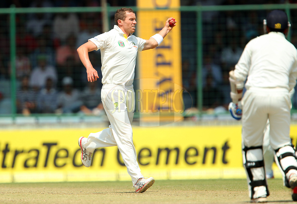Peter Siddle of Australia fields from his own bowling during day 2 of the 4th Test Match between India and Australia held at the Feroz Shah Kotla stadium in Delhi on the 23rd March 2013..Photo by Ron Gaunt/BCCI/SPORTZPICS ..Use of this image is subject to the terms and conditions as outlined by the BCCI. These terms can be found by following this link:..http://www.sportzpics.co.za/image/I0000SoRagM2cIEc