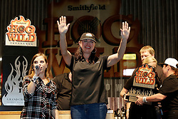 IMAGE DISTRIBUTED FOR SMITHFIELD - Suzanne Clark of Phoenix, AZ celebrates winning the Smithfield Hog Wild Throwdown contest as Smithfield representatives present her with the championship trophy at the American Royal World Series of Barbecue on Saturday, Oct. 29, 2016 in Kansas City, Kansas. Clark takes home a Ford F-150 XL pickup truck and $2,000 cash. (Colin E. Braley/AP Images for Smithfield)