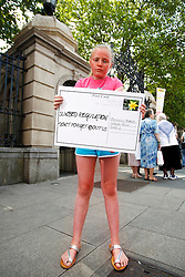 Repro Free: 26/06/2013<br /> Libby Simmons (10) from Mount Merrion pictured delivering a postcard to Oireachtas members reminding them of the Government&rsquo;s promise to publish legislation to protect young people from using cancer-causing sunbeds. The Irish Cancer Society launched a national campaign calling on Government to publish the long-awaited legislation to regulate sunbed use so that children and young people are protected from the risk of developing skin cancer. There is currently no regulation of sunbeds in Ireland, meaning that children under 18 and those with very fair skin can use sunbeds without proper warning or supervision. Picture Andres Poveda