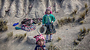 Children are playing beside the road in the mountains of bolivia