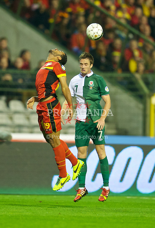 BRUSSELS, BELGIUM - Tuesday, October 15, 2013: Wales' Andy King in action against Belgium during the 2014 FIFA World Cup Brazil Qualifying Group A match at the Koning Boudewijnstadion. (Pic by David Rawcliffe/Propaganda)