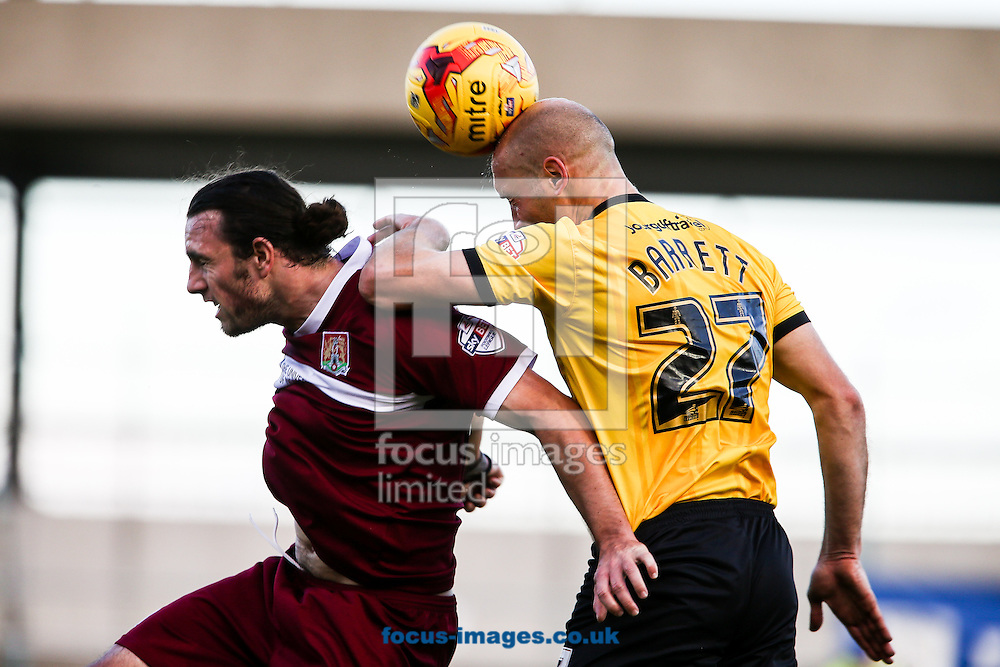 George Oakley of AFC Wimbledon (right) heads clear during the Sky Bet League 2 match at Sixfields Stadium, Northampton<br /> Picture by Andy Kearns/Focus Images Ltd 0781 864 4264<br /> 01/11/2014