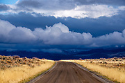 The road into the park with an oncoming storm.