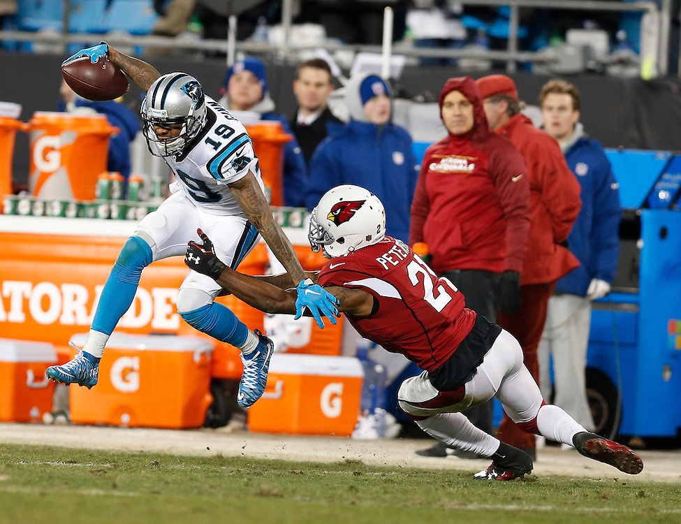 CHARLOTTE, NC - JAN 24:  Wide receiver Ted Ginn, Jr. #19 of the Carolina Panthers is tackled by cornerback Patrick Peterson #21 of the Arizona Cardinals during the NFC Championship game at Bank of America Stadium on January 24, 2016 in Charlotte, North Carolina.