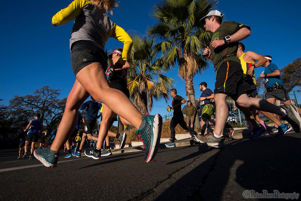 Runners run through Fair Oaks Village in the California International Marathon (CIM), Sunday Dec 3, 2017.<br /> photo by Brian Baer