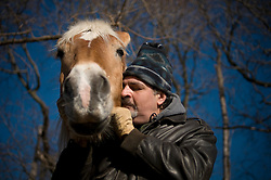 "Port Washington, NY : January 5, 2010 : Joseph Cesarelli, who is unemployed going on three years, volunteers to take care of horses at Sands Point Preserve on Long Island. ""It gives me a reason to wake up,"" he said."