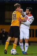 Luke Berry of Cambridge United  pushes Alex Lawless of Luton Town during the Skrill Conference Premier match at the Abbey Stadium, Cambridge<br /> Picture by David Horn/Focus Images Ltd +44 7545 970036<br /> 11/03/2014
