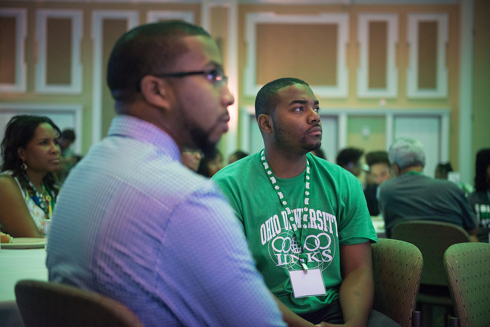 Tyrin Rome, right, and Brandon Chestnut, left, listen to Dr. Jason Pina, Ohio University Vice President for Student Affairs, as he speaks during the Black Alumni Reunion's Student and Alumni Networking event held at the Baker Center Ballroom on Friday, September 16, 2016.