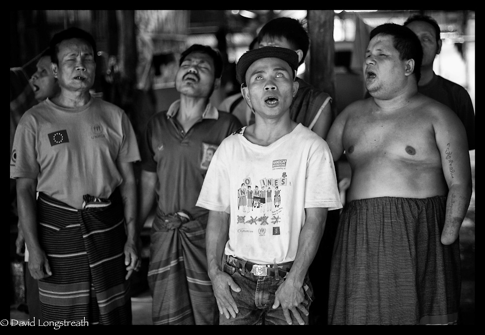 Ethnic Karen refugees, all blind the result for landmine explosions, sing in a choir at the Mae La refugee camp near Mae Sot, Thailand. (Photo by David Longstreath)