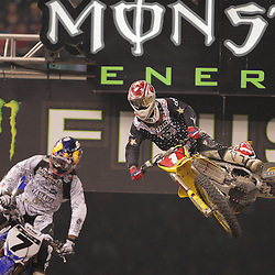 14 March 2009: James M Stewart (7) stays ahead of Chad Reed (1) during the Monster Energy AMA Supercross race at the Louisiana Superdome in New Orleans, Louisiana