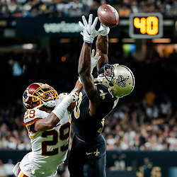 Nov 19, 2017; New Orleans, LA, USA; Washington Redskins cornerback Kendall Fuller (29) breaks up a pass to New Orleans Saints wide receiver Michael Thomas (13) during the second half of a game at the Mercedes-Benz Superdome. The Saints defeated the Redskins 34-31 in overtime. Mandatory Credit: Derick E. Hingle-USA TODAY Sports