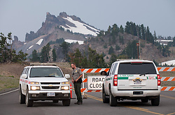 August 8, 2017 - Crater Lake National Park, OREGON, U.S - Park rangers block access to the West Rim Road at Crater Lake National Park due to a nearby wildfire. A large fire is burning in the park just west of the crater. Hot and dry conditions have made for a very active wildfire season in Oregon and much of the western United States. (Credit Image: © Robin Loznak via ZUMA Wire)