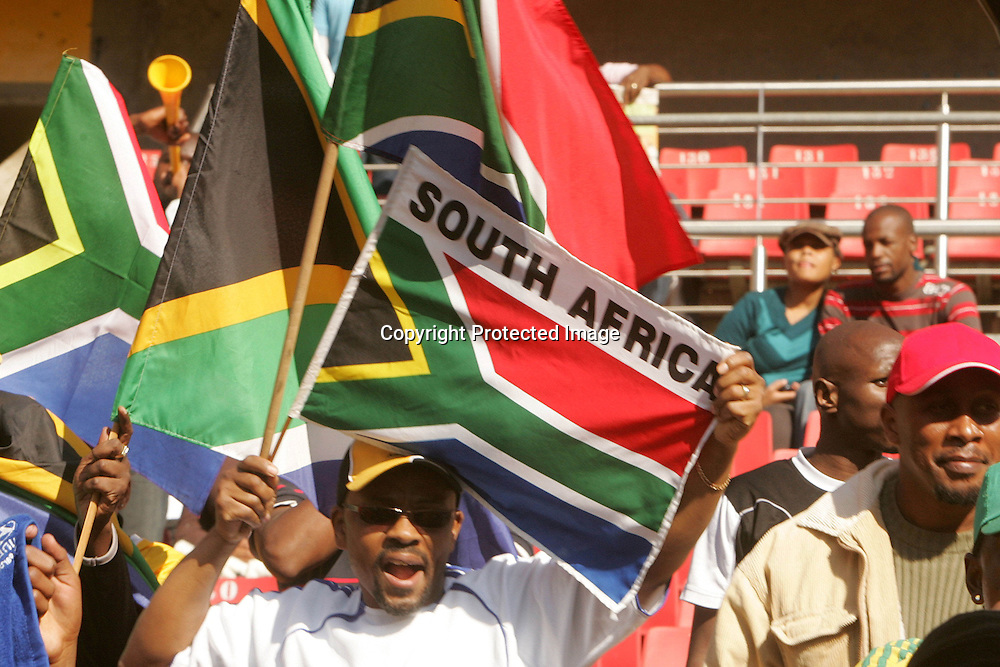 Fans celebrate during the opening match of the FIFA Confederations Cup between South Africa and Iraq held at Coca Cola Park in Johannesburg on the 14 June 2009.Photo by: Ron Gaunt/ SPORTZPICS