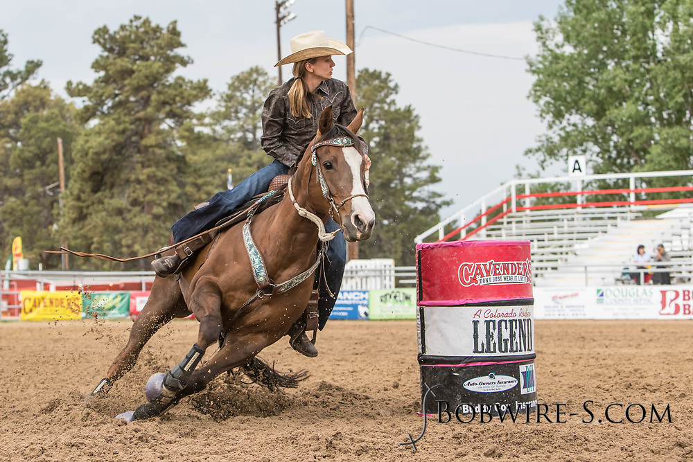 Kaylynn Cate makes her barrel racing run during slack at the Elizabeth Stampede on Sunday, June 3, 2018.