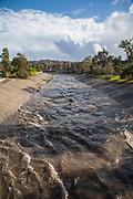 Ballona Creek rises dramatically after rainfall, Culver City, Los Angeles, California, USA