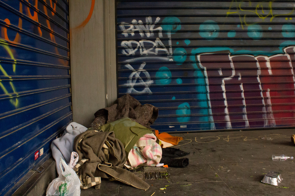 """February 2012, Athens, Greece. Beggar in the streets of Athens city center. Members of the European Parliament claim that homeless people in Europe are approximately 3.000.000 people while Michel Barnier, commissioner responsible for internal market and services, answers that the social services have not record the exact number of Europe's homeless as yet the term """"homeless"""" has not been defined by the responsible European authorities. In the meantime the streets of Athens are full of homeless people in almost every corner, mirroring the economy's downturn."""